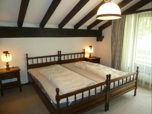 A bed or beds in a room at La Schmetta 5 (334 Fo)