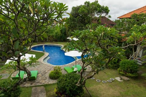 A view of the pool at Bali Wirasana Inn or nearby