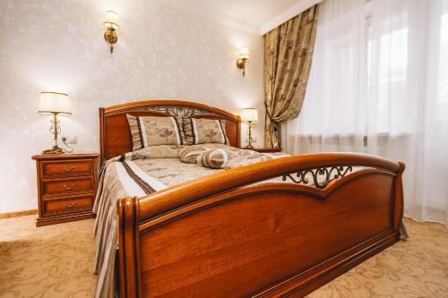 Кровать или кровати в номере Отель Чайковский