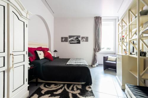 Un ou plusieurs lits dans un hébergement de l'établissement Residenza Romana Zucchelli
