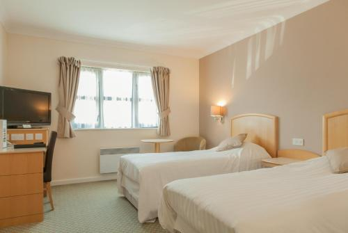 A bed or beds in a room at The Wiltshire