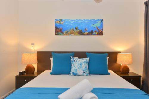 A bed or beds in a room at Reef Terraces on St Crispins