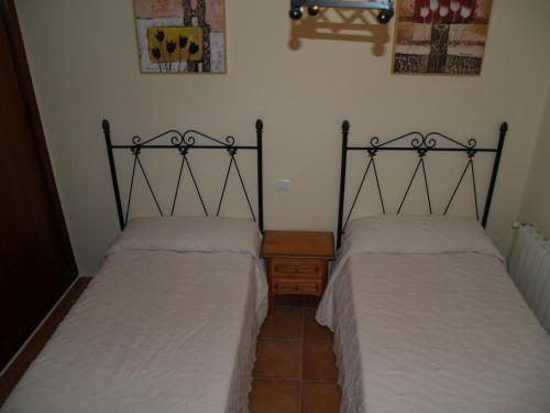 A bed or beds in a room at Casa Rural El Botánico