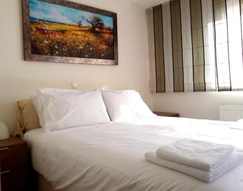 A bed or beds in a room at Elvita Athens Sea View Maisonette