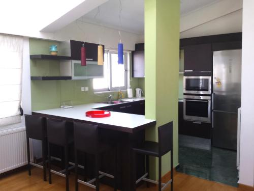 A kitchen or kitchenette at Elvita Athens Sea View Maisonette