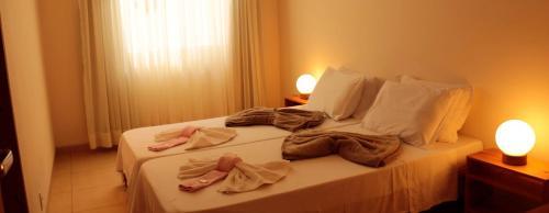 Cama ou camas em um quarto em Casa de Sarasvati
