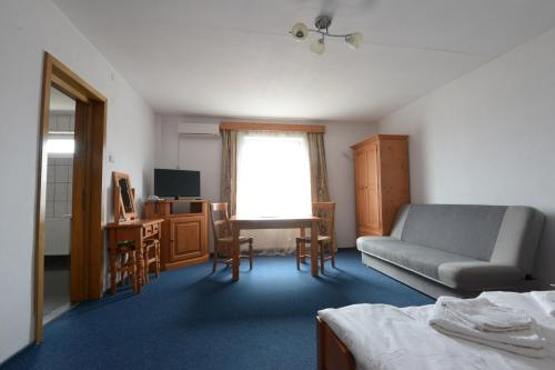 Zona de estar de Hotel Maier