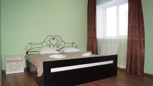 Кровать или кровати в номере Гостиничный Spa комплекс Shishka