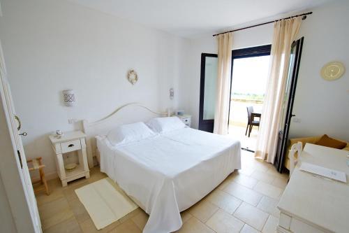 Ein Bett oder Betten in einem Zimmer der Unterkunft Borgobianco Resort & Spa – MGallery Hotel Collection