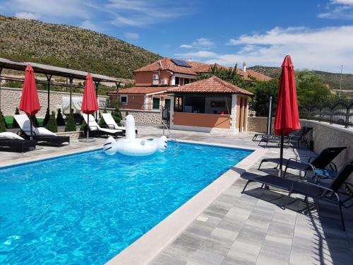The swimming pool at or close to Apartments Antonia