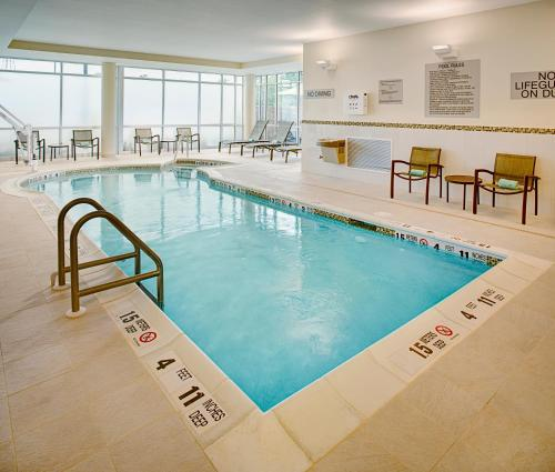 The swimming pool at or near SpringHill Suites by Marriott Carle Place Garden City