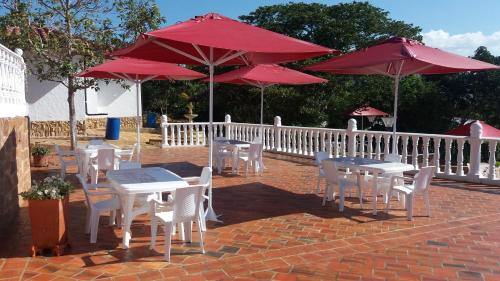 A restaurant or other place to eat at Finca Villa Alicia