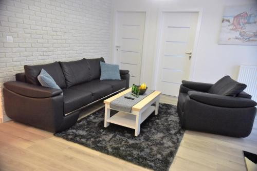 A seating area at Apartamenty Platan Opieszyn