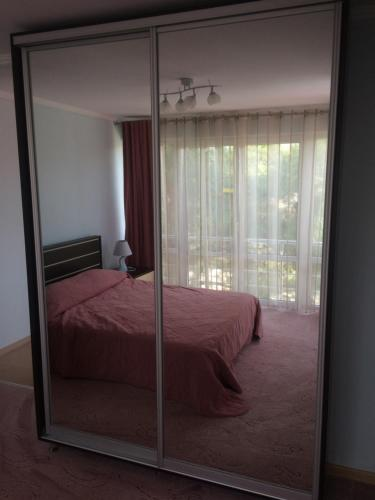 Кровать или кровати в номере Guest house Bavaria