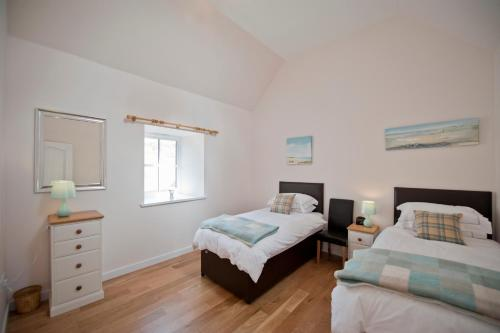 A bed or beds in a room at Lady Macbeths Rest