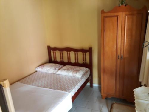 Cama o camas de una habitación en Suítes Dona Ilda