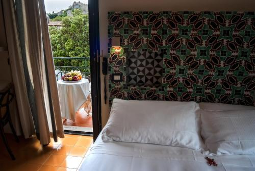A bed or beds in a room at La Moresca
