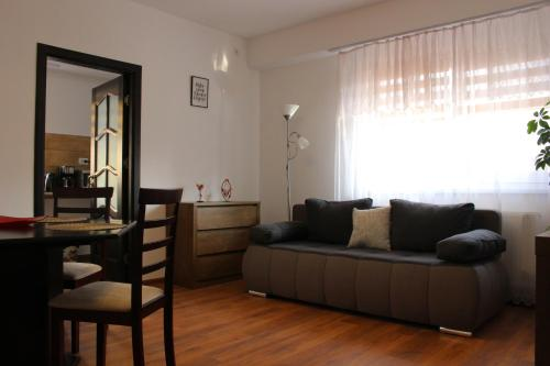 O zonă de relaxare la Still Apartament