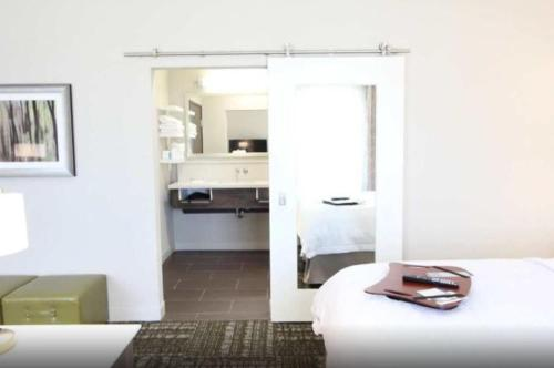A kitchen or kitchenette at Hampton Inn & Suites Dallas Market Center