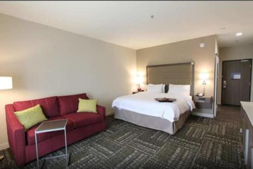 A bed or beds in a room at Hampton Inn & Suites Dallas Market Center