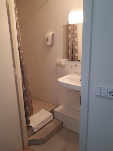 Een badkamer bij Hotel The Ark