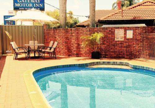 The swimming pool at or near Gateway Motor Inn
