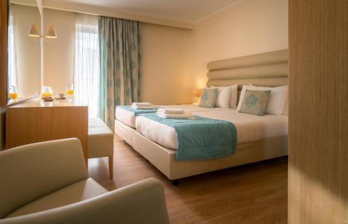 A bed or beds in a room at Galaxy Beach Resort BW Premier Collection