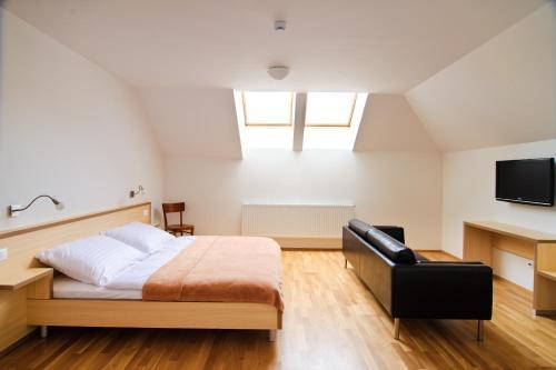Postel nebo postele na pokoji v ubytování Davidův mlýn