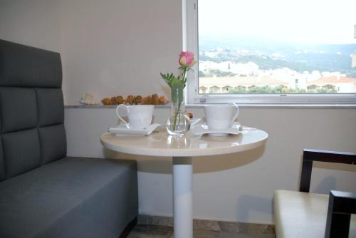 A seating area at Aria Hotel Samos Town