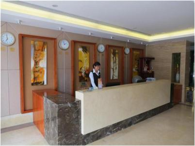 Staff members at Greentree Inn Shenzhen Kengzi Express Hotel