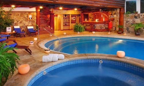 Бассейн в Nido del Cóndor Hotel & Spa или поблизости