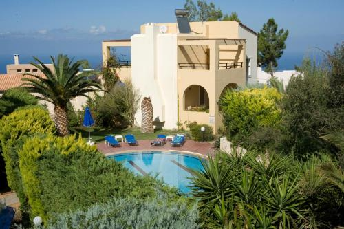 A view of the pool at Aloni Villas or nearby