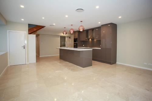 A kitchen or kitchenette at Design Sydney Home