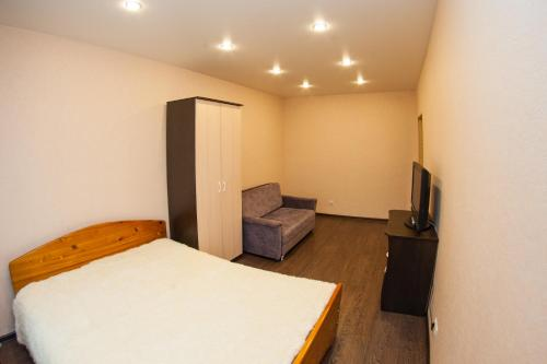 A bed or beds in a room at Apartment on Lenina 49