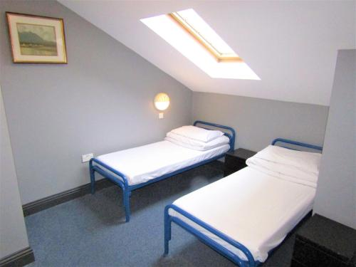 A bed or beds in a room at Sleepzone Hostel Galway City