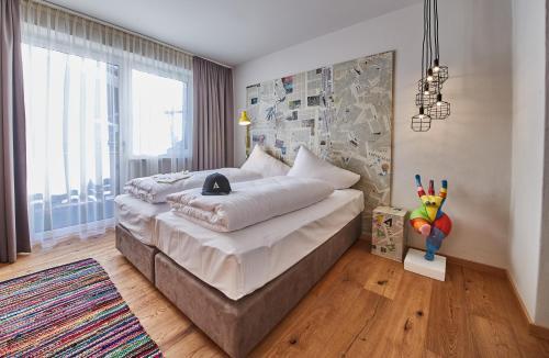 Ein Bett oder Betten in einem Zimmer der Unterkunft LALA arthotel