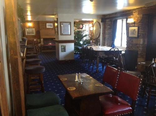 A restaurant or other place to eat at The Jolly Huntsman
