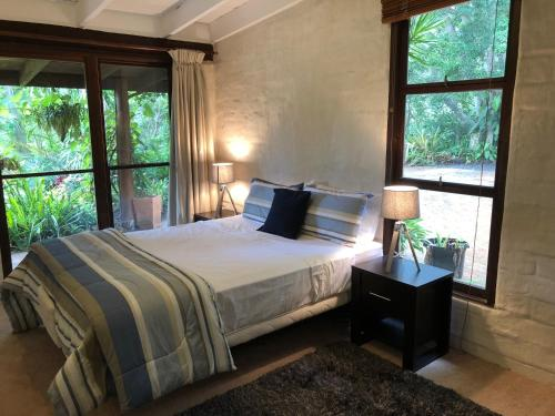 A bed or beds in a room at Hinterland Hideaway