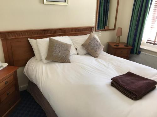 A bed or beds in a room at The Grafton Rooms