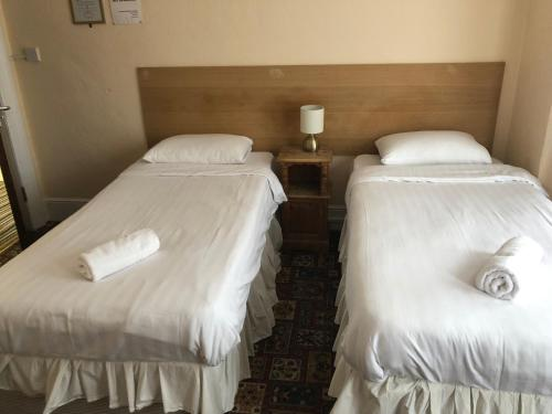 A bed or beds in a room at Arran Guest House