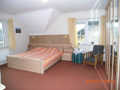 Ein Bett oder Betten in einem Zimmer der Unterkunft B&B De Boerderij