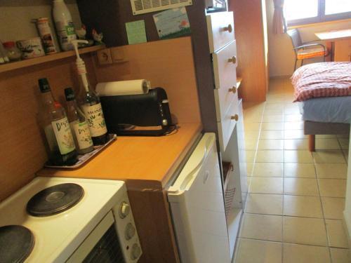Cuisine ou kitchenette dans l'établissement Chambre d'hôte Romarica