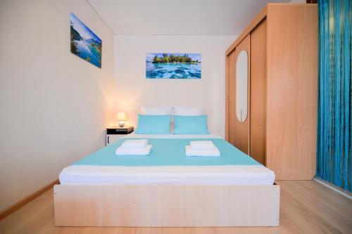 Кровать или кровати в номере Пять Звёзд Свет