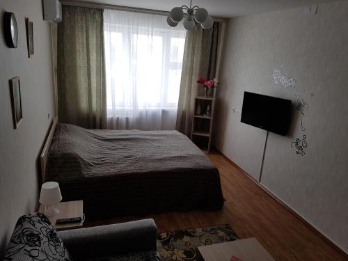 Кровать или кровати в номере Апартаменты GrInn 15 на Коммунальной