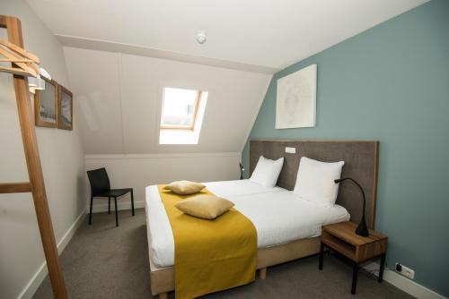 Ein Bett oder Betten in einem Zimmer der Unterkunft Vlierijck