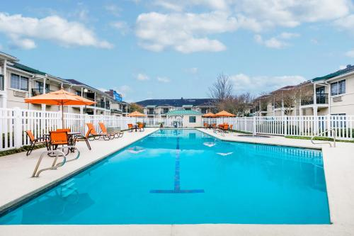 The swimming pool at or near Richmond Inn & Suites Trademark Collection by Wyndham
