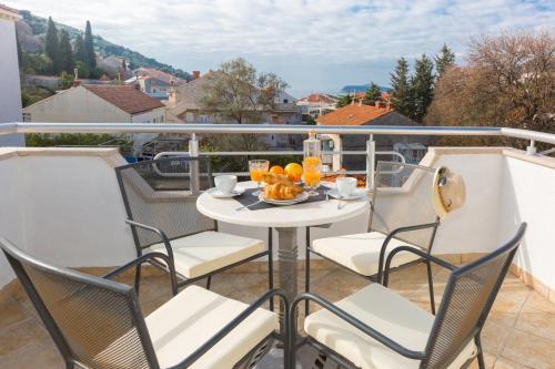 A balcony or terrace at Agape Duplex Apartment