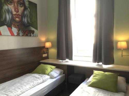Ein Bett oder Betten in einem Zimmer der Unterkunft Urban Stay Salzburg City