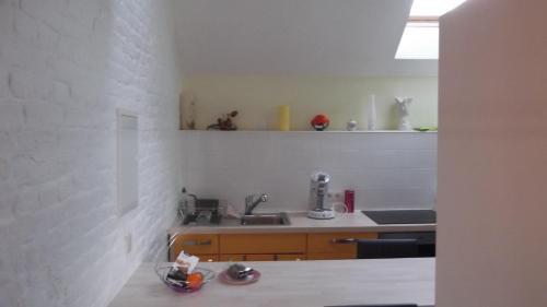 A kitchen or kitchenette at Ferme du Pont de Bois - Le Fenil