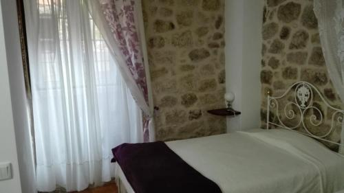 A bed or beds in a room at Casa Pires Mateus